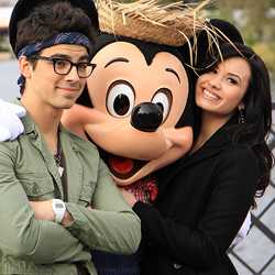 Celebrities Demi Lovato and Joe Jonas at Epcot