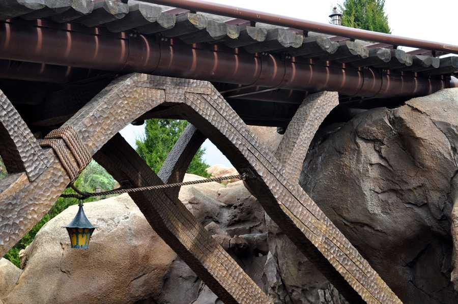 Bridge crossing the stream at the Seven Dwarfs Mine Train coaster