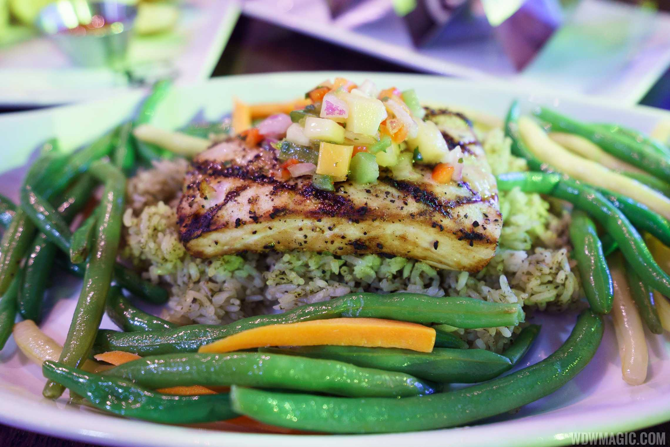 Fresh Florida Mahi Mahi - $29.99 Grilled Mahi Mahi topped with tropical fruit salsa, served with house-made cilantro rice and green bean blend