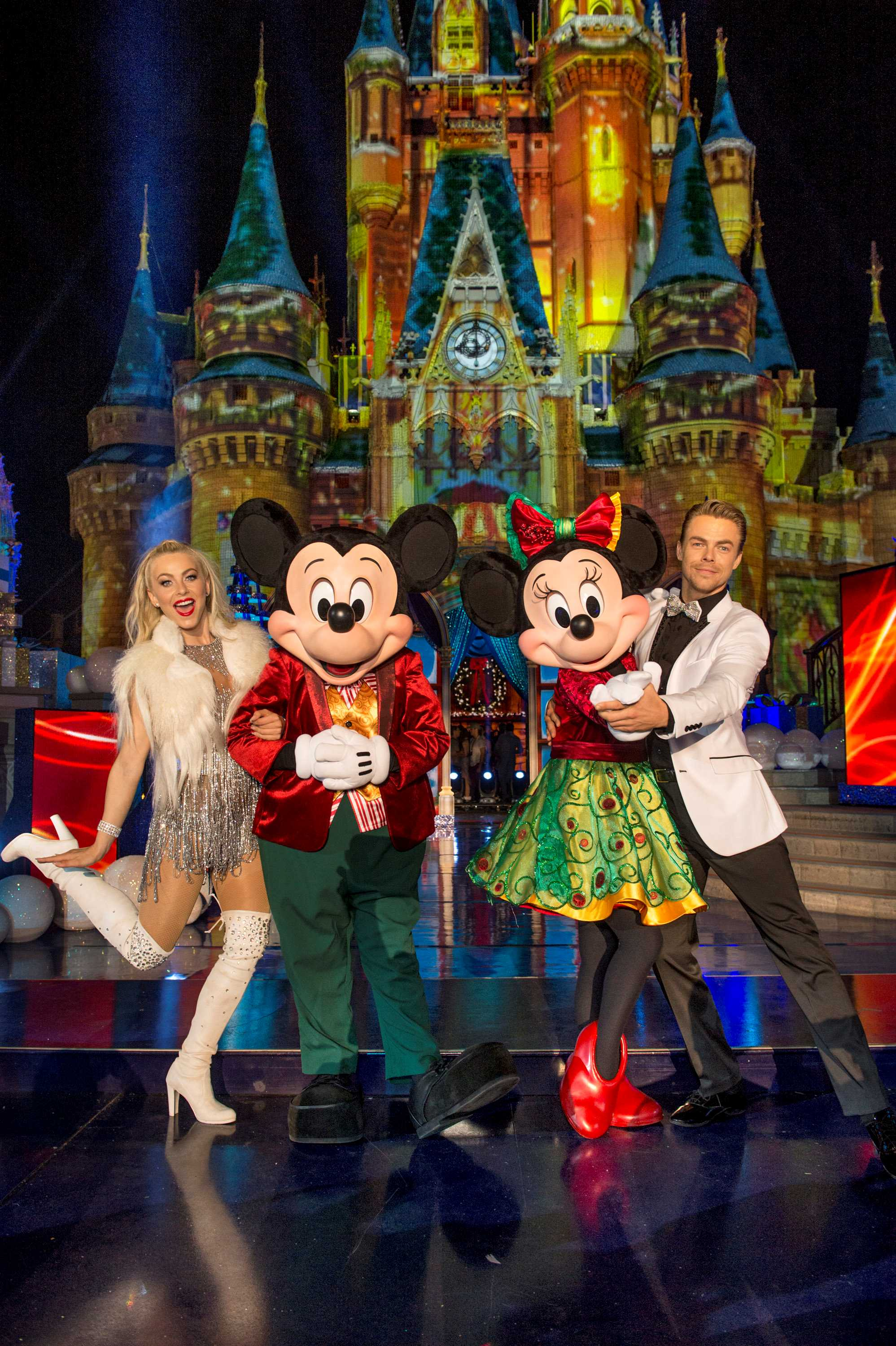 Julianne Hough and pro-dancer Derek Hough pose with Mickey Mouse and Minnie Mouse