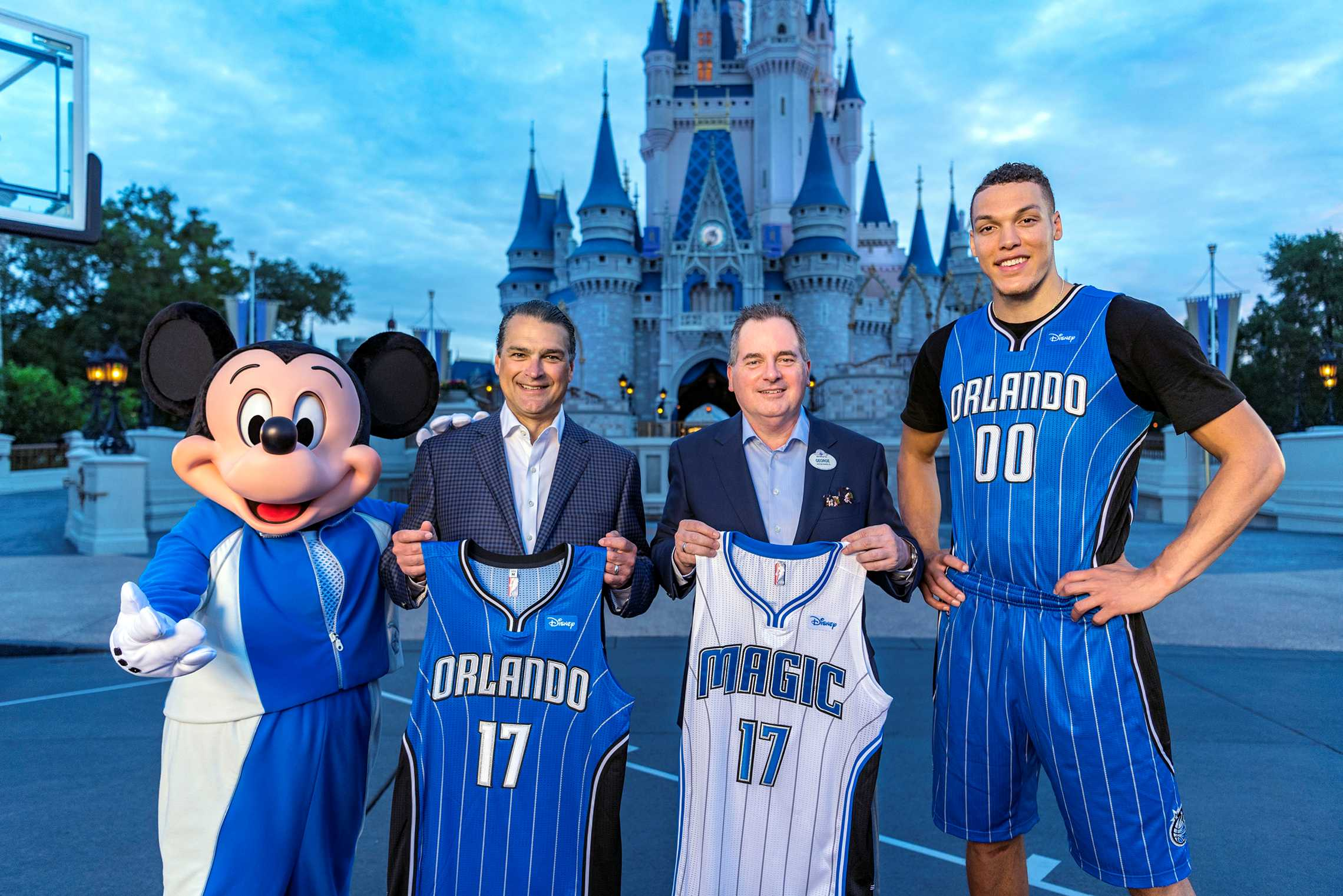 Orlando Magic CEO Alex Martins and Walt Disney World Resort President George A. Kalogridis pose with Orlando Magic star Aaron Gordon and Mickey Mouse as part of the announcement of Disney becoming the team's first jersey sponsor