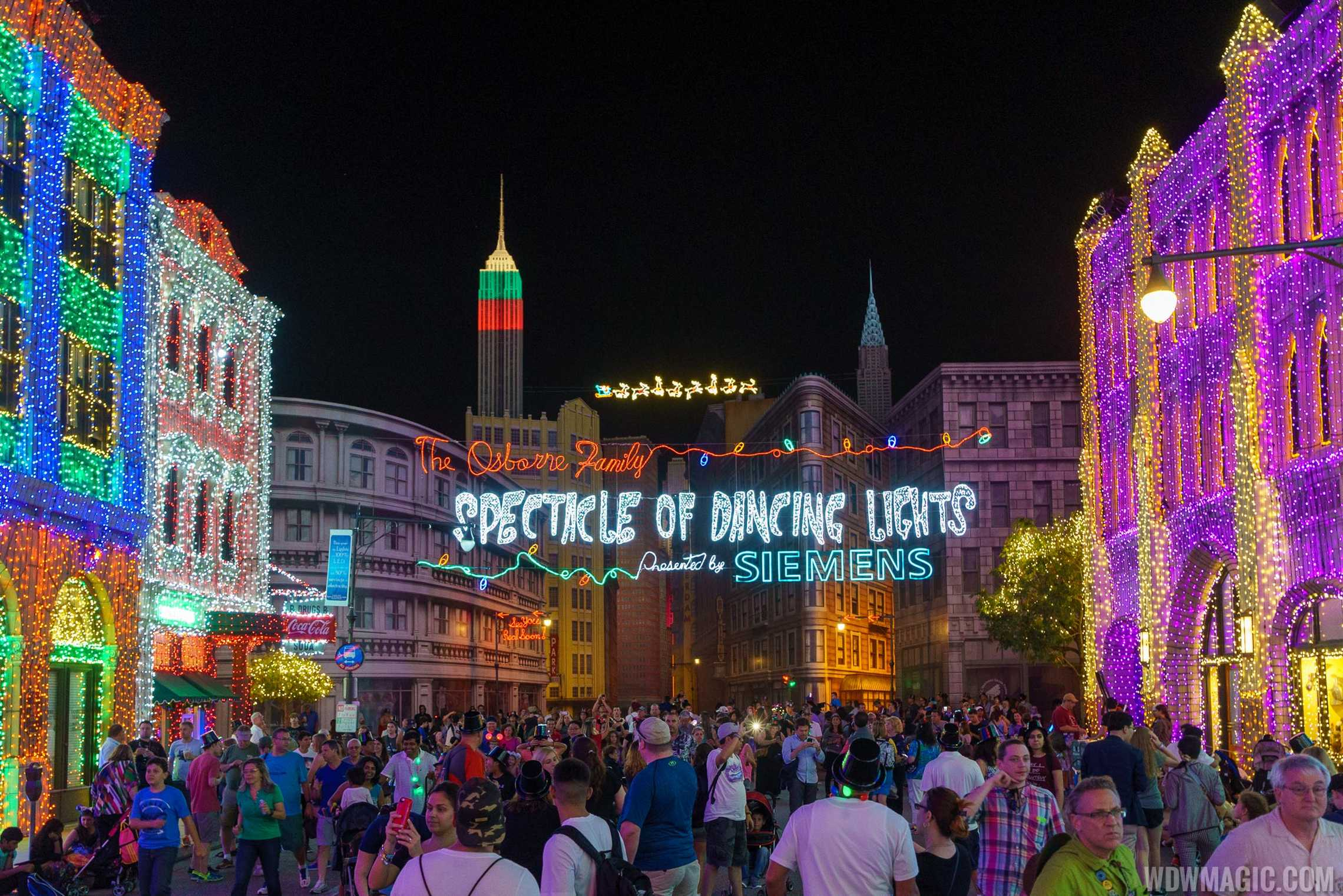 A packed Streets of American enjoys the Osborne Family Spectacle of Dancing Lights